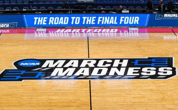 A view of the NCAA logo during the first round of March Madness on March 21, 2019, at XL Center in Hartford, Conn. The NCAA announced it plans to hold the 2021 Men's Division I tournament in a single geographic location.