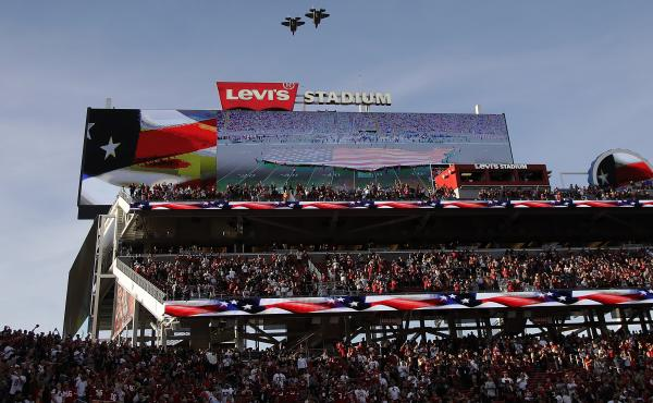 Military planes fly over Levi's Stadium on Thursday during the playing of the national anthem. A cheerleader took a knee during the pre-game anthem, and may be the first NFL cheerleader to do so.