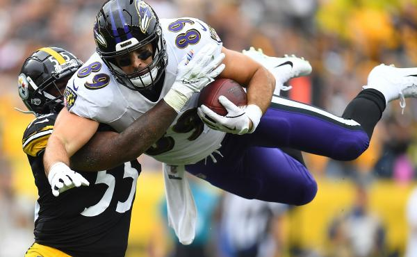 Mark Andrews, right, of the Baltimore Ravens hurdles Devin Bush, left, of the Pittsburgh Steelers during the first quarter at Heinz Field on Oct. 6, 2019 in Pittsburgh. This season, the Thanksgiving matchup between the two teams has been canceled due to a