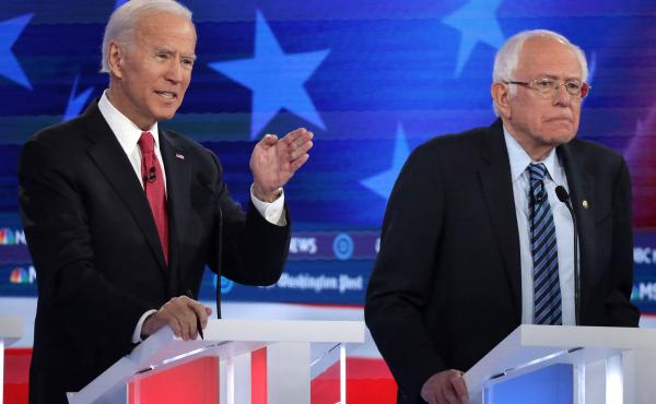 Former Vice President Joe Biden (left) and Sen. Bernie Sanders lead the crowded Democratic presidential primary field, according to the latest NPR/PBS NewsHour/Marist Poll. Above, they appear during the Democratic presidential primary debate in Atlanta on