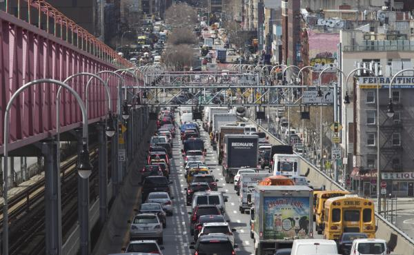 Traffic makes its way into Manhattan over the Williamsburg Bridge in March 2019. New checkpoints at New York City's major bridges, tunnels and other sites are meant to drive home the message that 14-day quarantine rules are mandatory for people returning
