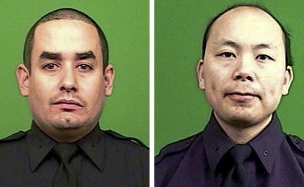 Officer Rafael Ramos (left) and Wenjian Liu were killed on Saturday in an attack by a gunman in a Brooklyn neighborhood.