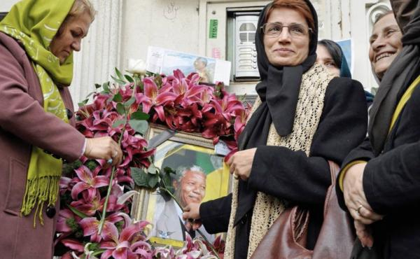 Iranian human rights lawyer Nasrin Sotoudeh with a poster of South Africa's Nelson Mandela, in a scene from the Nasrin documentary.