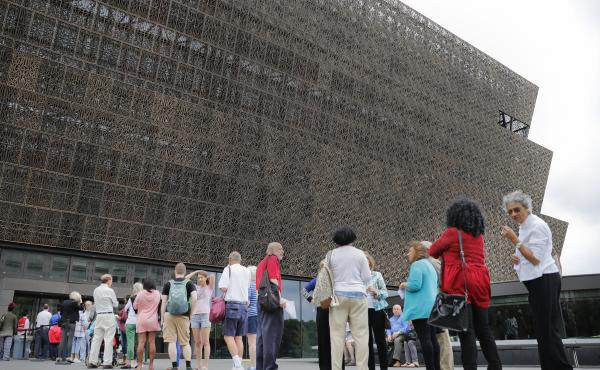 Lucille Simpson, far right, and her daughter Gwendolyn Norman, both from Detroit, Mich., wait in line to enter the Smithsonian National Museum of African American History and Cultural on the National Mall in Washington, D.C., on May 1.