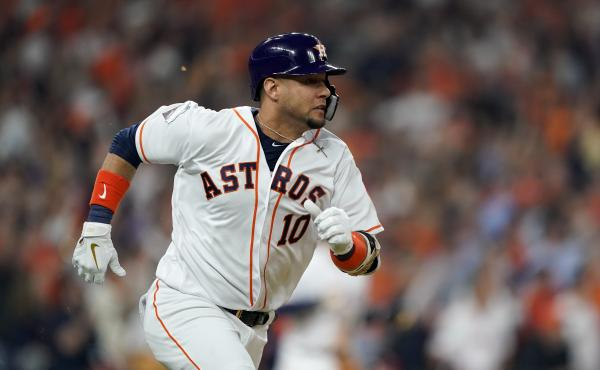 Houston Astros' Yuli Gurriel reacts hits a two-run scoring double during the first inning of Game 1 of the World Series against the Washington Nationals Tuesday in Houston.