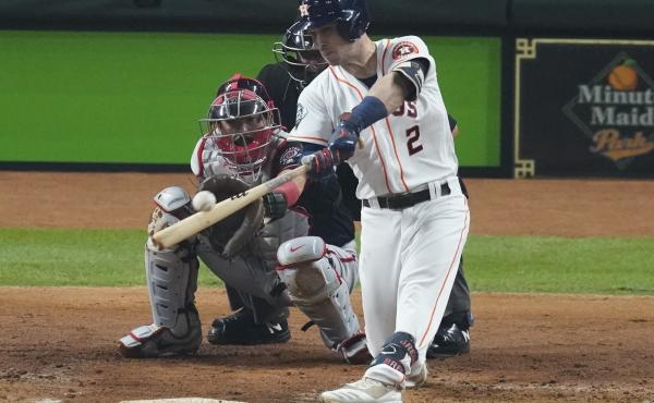 The Houston Astros' Alex Bregman hits a two-run home run during the first inning of Game 2 of the World Series against the Washington Nationals in Houston.