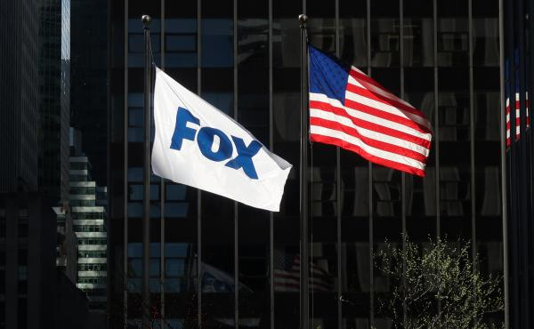 A flag with the new logo for FOX flies outside of the corporate headquarters on 6th Avenue on April 24, 2019 in New York City.