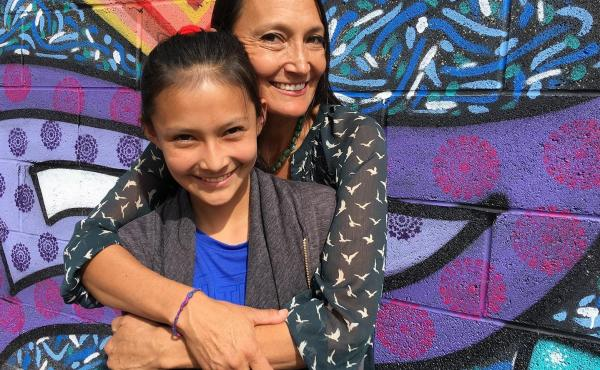 Traditional Diné medicine practitioner Jeneda Benally, pictured here with her daughter Dahi, is trying to preserve cultural wisdom in danger of being lost during the pandemic.
