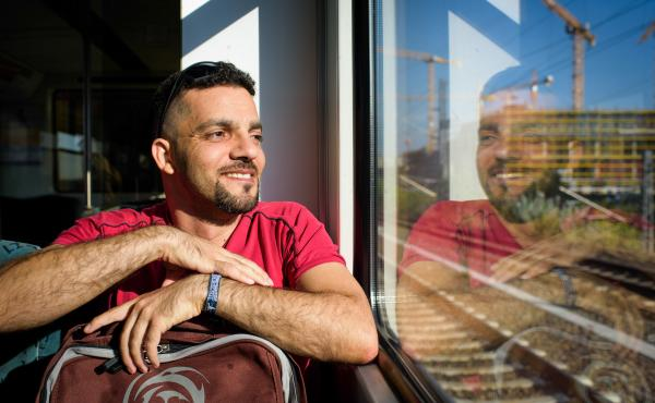 Aktham Abulhusn rides the subway on his way to Berlin Alexanderplatz. He came from Syria to Germany in early 2015 on a student visa and now lives there on a refugee visa. Now that his German language skills are improving, he is trying to find a girlfriend