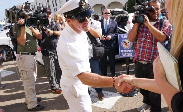 Navy Special Operations Chief Edward Gallagher celebrates after being acquitted of premeditated murder at Naval Base San Diego on July 2. Gallagher was found not guilty in the killing of a wounded Islamic State captive in Iraq in 2017.