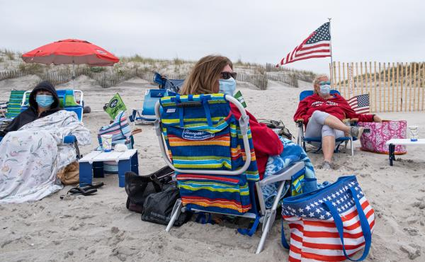 Memorial Day weekend at Robert Moses State Park on Fire Island, N.Y. As the pandemic continues, Harvard's Dr. Ashish Jha says, mask wearing, social distancing and robust strategies of testing and contact tracing will be even more important.