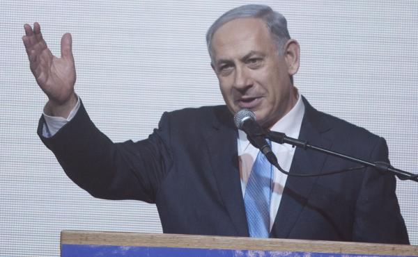 Israeli Prime Minister Benjamin Netanyahu speaks to supporters Tuesday at his election campaign headquarters in Tel Aviv. If he succeeds in forming a coalition government, he would begin a historic fourth term.