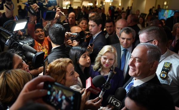 Israeli Prime Minister Benjamin Netanyahu and his wife Sara Netanyahu talk to the press after attending an exhibit on Jerusalem's Jewish history at the United Nations on Thursday.