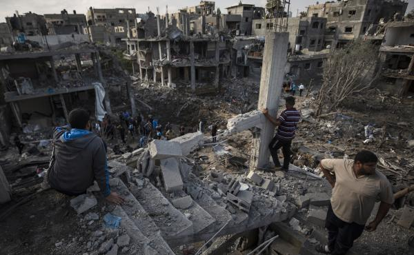 Palestinians inspect their destroyed houses Friday following overnight Israeli airstrikes in Beit Hanoun in the northern Gaza Strip.