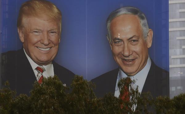 An election campaign billboard in Tel Aviv shows Israeli Prime Minister Benjamin Netanyahu with his close ally President Trump. Seeking re-election under a cloud of criminal investigations, analysts say Netanyahu has been channeling a Trump-style approach