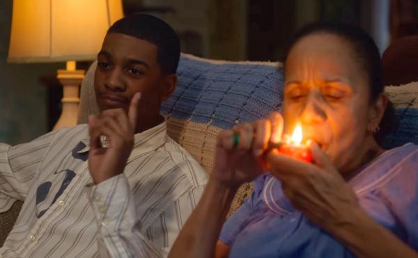 Brett Gray (left) as Jamal Turner, and Peggy Blow as Abuela, a lovable, pot-smoking grandma, in the first season of the Netflix teen drama On My Block.
