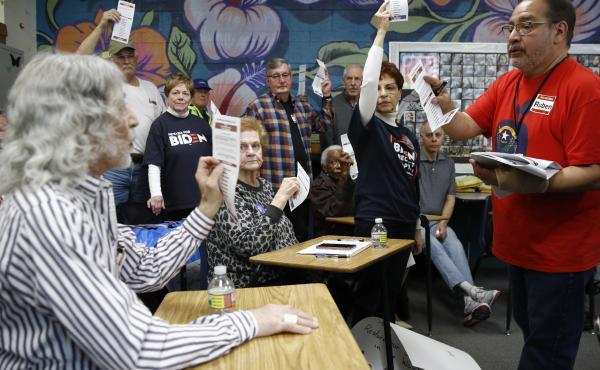 A precinct leader, right, counts votes at a caucus location at Coronado High School in Henderson, Nev., on Saturday.