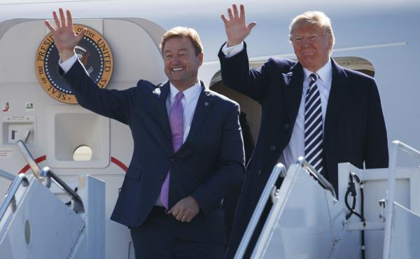 President Trump arrives with Sen. Dean Heller in Nevada on Saturday for a campaign rally.