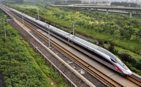 A Fuxing bullet train, China's latest high-speed train, arrives at a train station in northern China's Tianjin municipality.