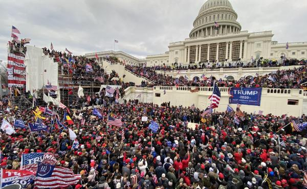 Pro-Trump extremists attacked the U.S. Capitol on Jan. 6. The acting U.S. Capitol Police chief apologized to Congress Tuesday for the department's failure to secure the building.