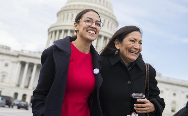 Democratic Rep.-elect Alexandria Ocasio-Cortez of New York (left) has pledged to pay her interns $15 an hour. She is seen here with Democratic Rep.-elect Deb Haaland of New Mexico.