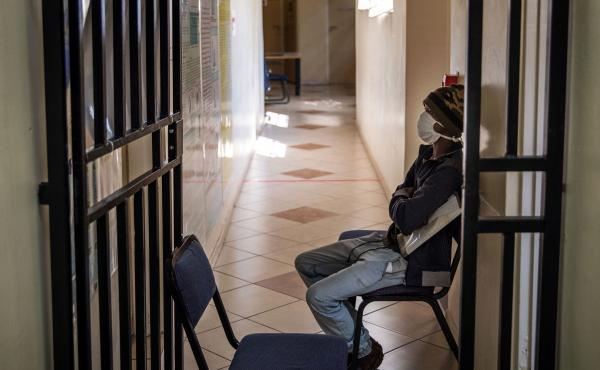 A South African patient with drug-resistant tuberculosis waits to be seen by a doctor at a Johannesburg hospital.