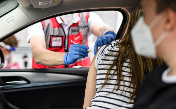 A woman receives the Johnson & Johnson COVID-19 at a drive-in vaccination event last week in Meerbusch, Germany.