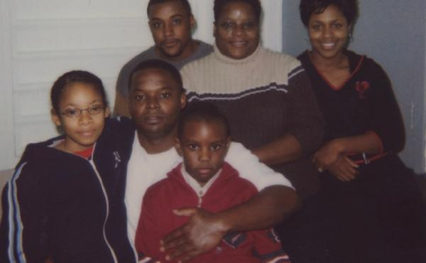 Shanaye Poole (left) next to her father, Toforest Johnson, during a family visit to see him in prison in the early 2000s.