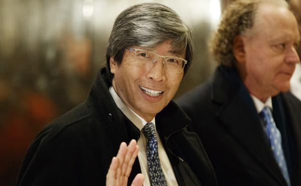 In this Jan. 10, 2017, file photo, pharmaceuticals billionaire Dr. Patrick Soon-Shiong waves as he arrives in the lobby of Trump Tower in New York for a meeting with President-elect Donald Trump. Soon-Shiong will take over the L.A. Times on Monday.