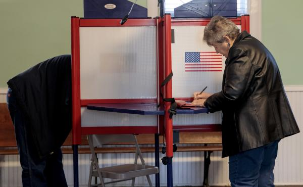 Voters cast their midterm ballots on Nov. 6, 2018 at Briles Schoolhouse in Peoria Township, Kan.