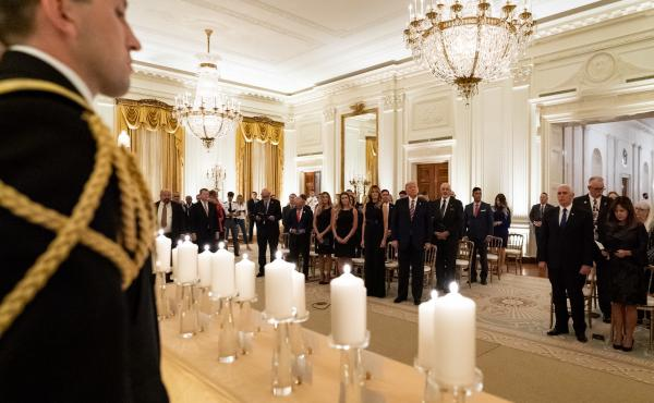 "President Donald Trump and First Lady Melania Trump join guests in singing ""America the Beautiful"" during a reception in honor of Gold Star Families on Sept. 27, in the East Room of the White House."