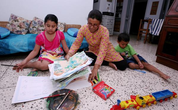 Dola Banerjee homeschools her children in New Delhi in August.