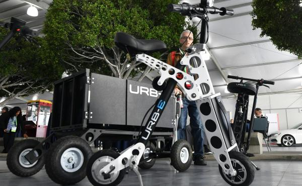 The URB-E electric folding bicycle is displayed Nov. 28 inside the Technology Pavilion at the 2017 LA Auto Show.