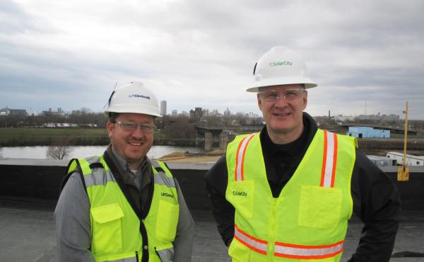 David Vawter (left), project manager at LPCiminelli and Steve James, senior vice president of Operations at SolarCity, on the roof of the factory in South Buffalo.