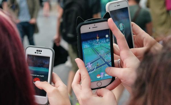 People play Pokémon Go in New York City on July 25. The New York governor's ban on playing the game will apply to nearly 3,000 sex offenders currently on parole.