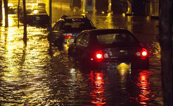 Vehicles sit in high floodwater during a storm surge associated with Superstorm Sandy in 2012, near the Brooklyn-Battery Tunnel in New York.