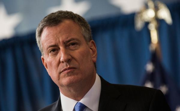 New York City Mayor Bill de Blasio said Sunday that the city will no longer use its previous threshold for closing schools.
