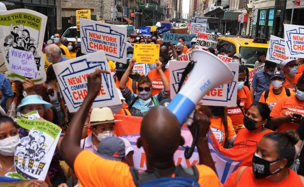 Housing activists and community members march toward the New York City office of Gov. Kathy Hochul calling for a stop to evictions on Tuesday in New York City. The state extended its eviction moratorium on Wednesday.