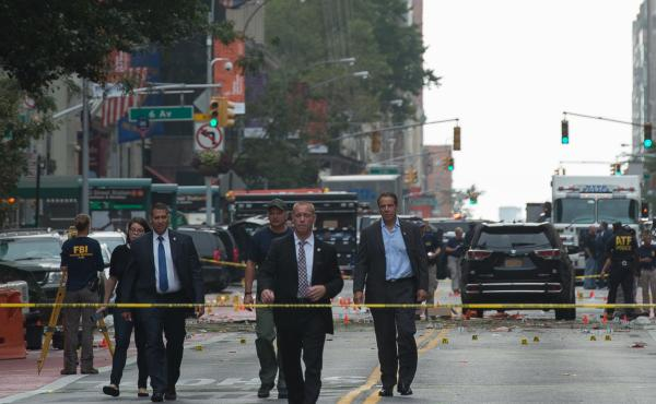 New York Governor Andrew Cuomo (R) visits the scene of an explosion on West 23rd Street Sept. 18, 2016 in New York. An explosion rocked one of the most fashionable neighborhoods of New York, injuring 29 people, one seriously, a week after America's financ