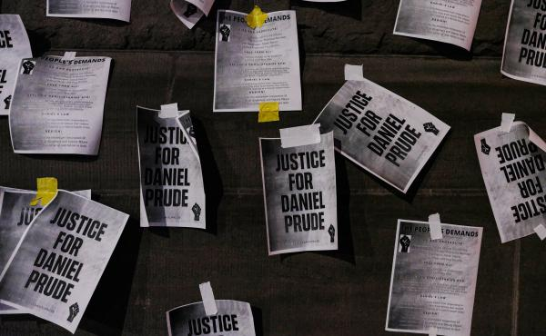 """Signs calling for """"Justice for Daniel Prude"""" were plastered to the exterior walls of City Hall in Rochester, N.Y., on Sept. 8, the seventh consecutive night of protests following the release of bodycam footage showing the March arrest that preceded his de"""