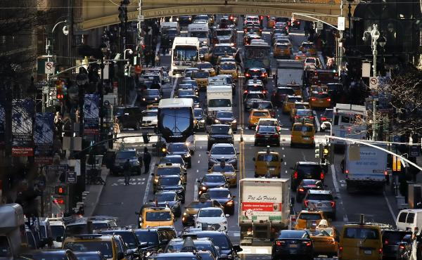 After gaining approval from state lawmakers, New York will become the first U.S. city to levy fees on motorists who drive on some of its most congested streets. Here, traffic fills 42nd Street in Midtown Manhattan in January 2018.