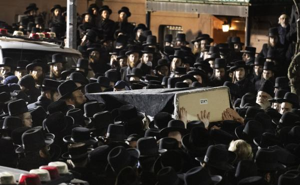 Orthodox Jewish men carry Moshe Deutsch's casket outside a Brooklyn synagogue earlier this month. Deutsch was killed in a shooting inside a Jersey City, N.J., kosher food market.
