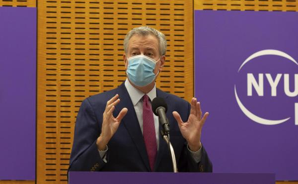 New York City Mayor Bill de Blasio announced that sheriff's deputies will be deployed to enforce quarantine protocols for travelers arriving from the United Kingdom. The mayor is seen above on Dec. 14. while delivering remarks ahead of the first COVID-19