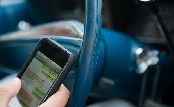A bill in New York would allow police to examine drivers' phones to see whether they were using the device at the time of an accident.