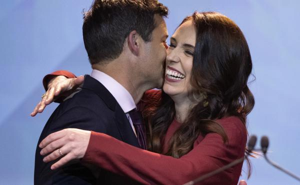 New Zealand Prime Minister Jacinda Ardern, right, is congratulated by her partner Clarke Gayford following her victory speech to Labour Party members at an event in Auckland, New Zealand on Saturday.