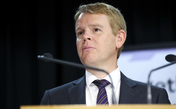 """New Zealand Minister for COVID-19 Response Chris Hipkins looks on during a news conference at Parliament last month where he and Prime Minister Jacinda Ardern announced plans for a quarantine-free """"travel bubble"""" between New Zealand and Australia."""