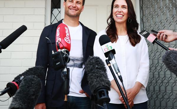 New Zealand Prime Minister Jacinda Ardern and her partner Clarke Gayford speaking reporters in Auckland, New Zealand.