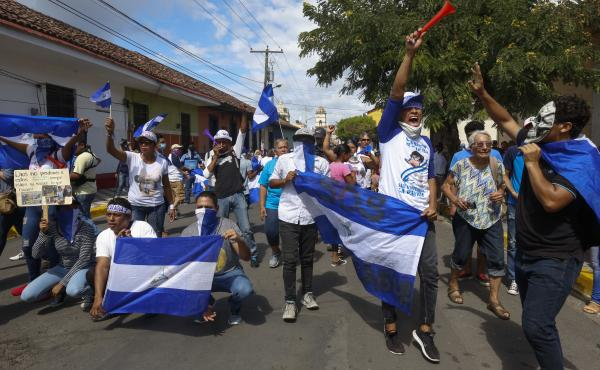 Anti-government demonstrators protest in Granada, Nicaragua. Hundreds of people have been killed in the government's brutal suppression of protests that erupted in April.