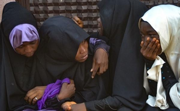 Mourners attend the burial of people killed in violent clashes in Abuja, Nigeria's capital, between Nigerian soldiers and members of the Islamic Movement of Nigeria.