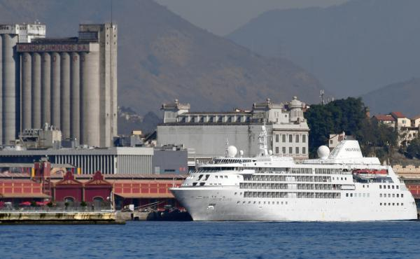 The U.S. men's and women's basketball teams will reportedly stay on the Silver Cloud cruise ship rather than the Athletes' Village during the Olympic Games that start in Rio de Janeiro on Friday. The cruise ship is shown here on Monday at Rio's Maua Pier.